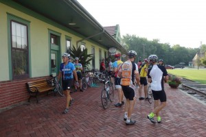 BikeMO Riders rest at the historic Katy Depot in Boonville
